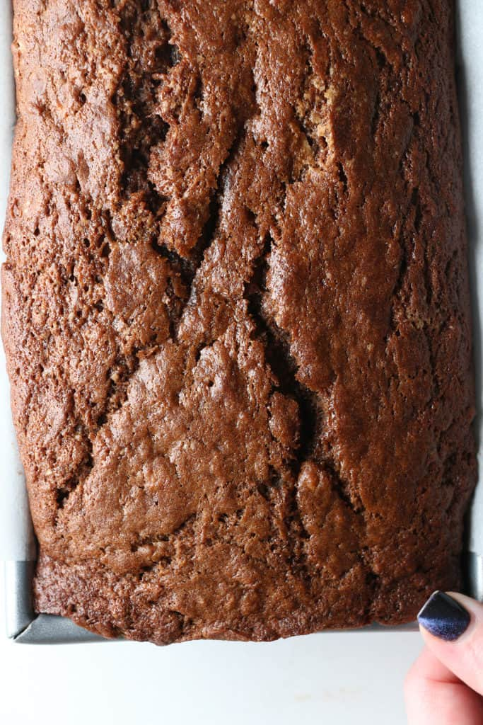 Chocolate Banana Bread with a hand at the bottom right