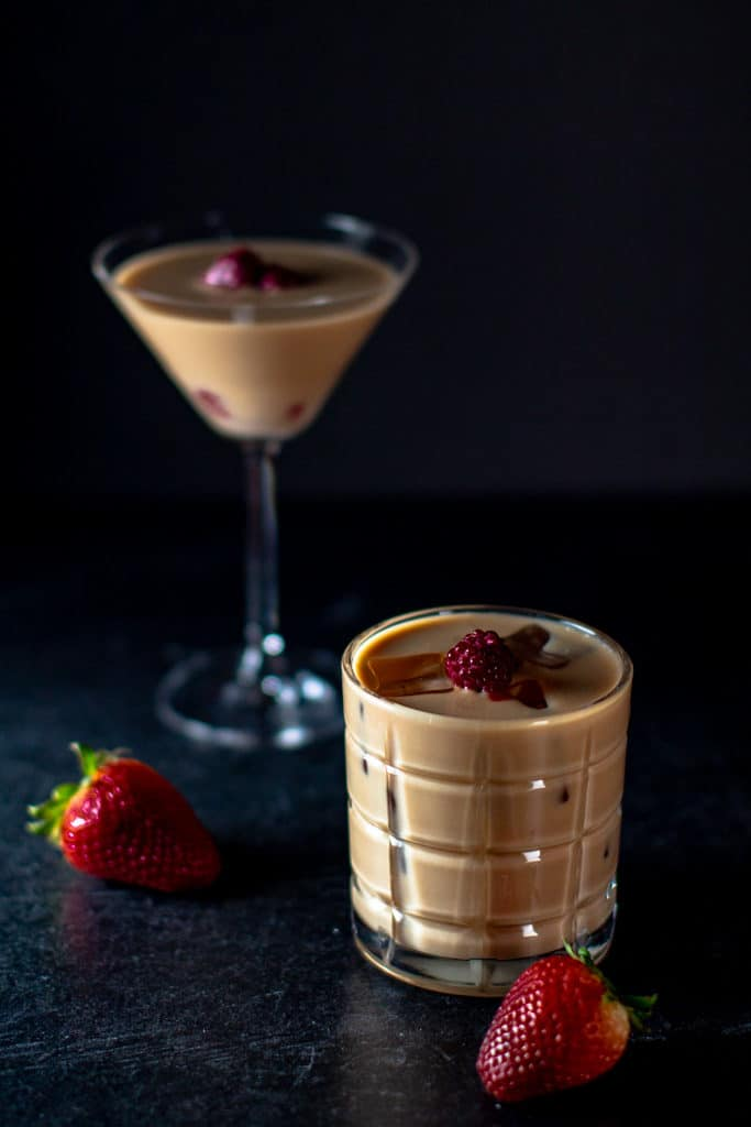 Two nuts and berries cocktails with two strawberries